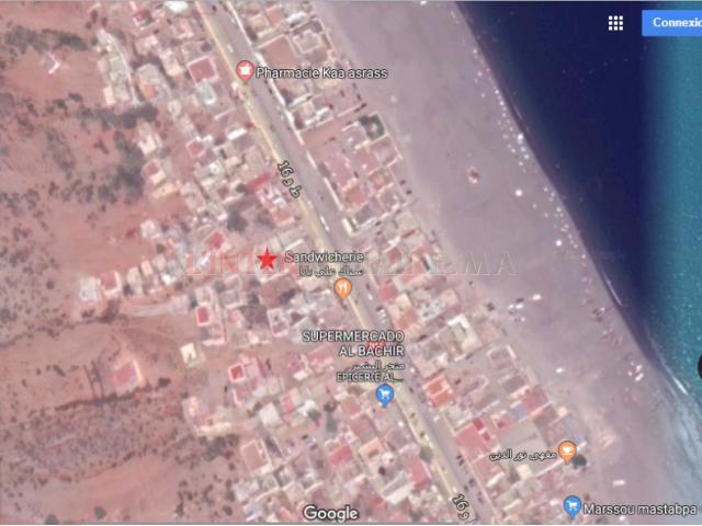 maison titré sur la plage R+2